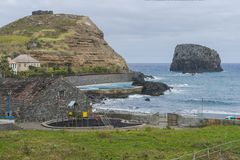 Porto da Cruz. Coast line , view on cliff and playground a small town Porto da Cruz by the shore of the Atlantic ocean. North side of Madeira Island , Portugal royalty free stock image