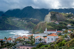 Porto da Cruz town surrounded by volcanic rocks and mountains, Madeira island Royalty Free Stock Photos