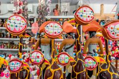 Porto de Galinhas beach, Ipojuca, Pernambuco, Brazil - September, 2018: Giraffes craft statues with funny teeth and dental stock photo