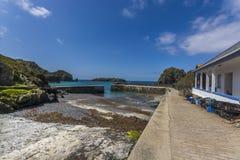 Porto di pesca della baia di Mullen e frangiflutti storici Fotografia Stock Libera da Diritti