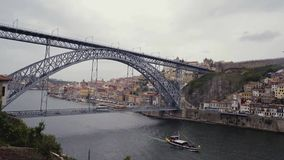 Porto, Dom Luis I bridge City scenery castle and ribeira. Boat passing by on river. Seagulls stock footage
