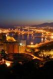 Porto e arena di Malaga alla notte fotografia stock libera da diritti