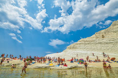 PORTO EMPEDOCLE, ITALY - AUGUST, 2015: Some tourists in the beach Scala dei Turchi, one of the most beautiful beaches in Sicily, o. N August, 2015, in Porto Royalty Free Stock Photos