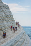 PORTO EMPEDOCLE, ITALY - AUGUST, 2015: Some tourists in the beach Scala dei Turchi, one of the most beautiful beaches in Sicily, o Stock Photo