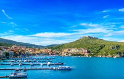 Porto Ercole village and harbor in a sea bay. Aerial view, Argentario, Tuscany, Italy. Porto Ercole village and boatd in harbor in a sea bay. Filippo fort on stock photos