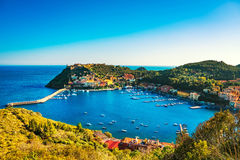 Porto Ercole village and harbor in a sea bay. Aerial view, Argen Royalty Free Stock Photography