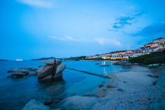 Porto Faro. Shot at dusk in the village of Porto Faro in Sardegna - Nobody on the beach with citylights in the background - Italy 2008 stock image