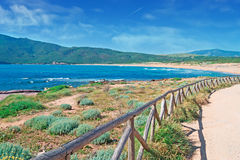 Porto Ferro palisade. Porto Ferro beach with a wooden palisade in the foreground Stock Photo