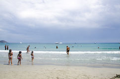 Porto Giunco, Italy-AUGUST 23: Unidentified people in Blue beach. With some people and grey cloudy sky on August 23. 2014 in Porto Giunco, Italy (Sardinia Stock Images