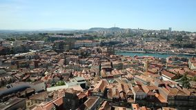 Porto historic center aerial. Panoramic views of historic center of Porto in Portugal from Clerigos Tower, one of the landmarks and icon of Oporto. Urban stock footage
