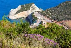 Porto Katsiki beach (Lefkada, Greece). Flowers and summer Porto Katsiki beach on Ionian Sea (Lefkada, Greece) view from up Stock Photos