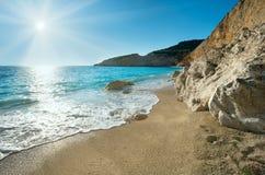 Porto Katsiki beach (Lefkada, Greece). Beautiful summer white Porto Katsiki beach on Ionian Sea (Lefkada, Greece) with sun in sky Royalty Free Stock Images