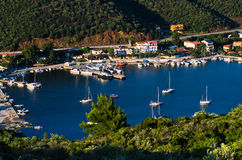 Porto Koufo harbor with a lot of anchored sailboats at sunset, west coast of Sithonia Stock Photography