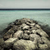 Porto Mari Curacao. Rocks, stones in the water at Porto Mari (Marie) beach Curacao stock photography