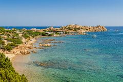Porto Massimo sand beach ,and sailing yachts at anchor. Royalty Free Stock Photos