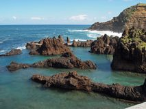 Porto Moniz Lava Rock Pools. Lava pools at Porto Moniz, Madeira Portugal.  Porto Moniz is a popular tourist destination in Madeira, Portugal Royalty Free Stock Image