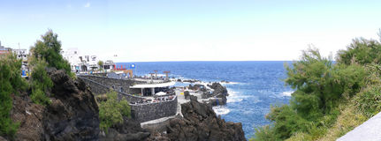 Porto Moniz on the North West Coast where the Mountains in the north of the Island of Madeira meet the Atlantic Ocean. Porto Moniz seems to have fallen from royalty free stock photo