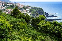 Porto Moniz on the North West Coast where the Mountains in the north of the Island of Madeira meet the Atlantic Ocean Royalty Free Stock Image