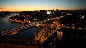 Porto night skyline. Aerial view of iconic Dom Luis I on Douro River from Miradouro da Serra do Pilar at Vila Nova de Gaia, Porto, Portugal. Picturesque urban stock video footage
