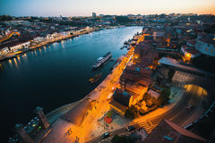 Porto old town on the Douro River at night time. Stock Photos