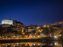 Porto old town and landmark bridge in portugal at night Stock Photo