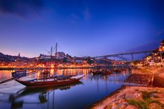 Porto, old town skyline with the Douro river and rabelo boats. Porto, Portugal - May 18, 2018: Porto, old town skyline with the Douro river and rabelo boats. Is Stock Image