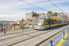 Porto Oporto metro subway tram train railway at Douro river bridge, empty street. Porto Oporto metro subway tram train railway rail at bridge over Douro river Stock Photo