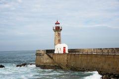 Porto Pí Lighthouse. Old Porto`s lighthouse and harbor waves Stock Photo