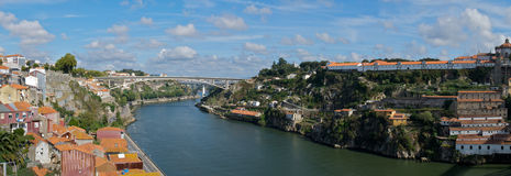 Porto Panorama. A panoramic view of the skyline in Porto, Portugal, with a bridge and tile-roofed houses Royalty Free Stock Image