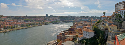 Porto Panorama. A panoramic view of the skyline in Porto, Portugal, with traditional architecture in the foreground and the urban center in the distance. The Royalty Free Stock Photo