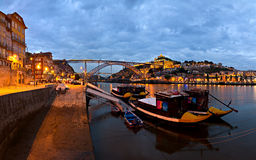 Porto panorama at night, Portugal. Panorama old Porto river Duoro, vintage port transporting boats, old town, town of Gaia and famous bridge Ponte dom Luis Royalty Free Stock Photography