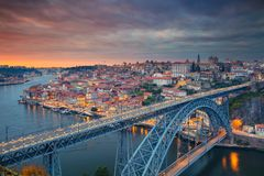 Porto, Portugal. Aerial cityscape image of Porto, Portugal with the famous Luis I Bridge and the Douro River during dramatic sunset royalty free stock images