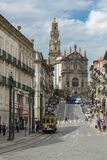 Old historic tram riding through Clerigos street in city of Port. Porto, Portugal - April 22, 2018: Old historic tram riding through Clerigos street in city of royalty free stock photography