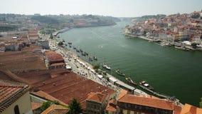 Douro River Porto. Porto, Portugal - August 13, 2017:Aerial view time lapse of Dom Luis I Bridge, Ribeira Waterfront and Oporto skyline from Vila Nova de Gaia stock video footage