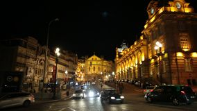 Porto city by night. Porto, Portugal - August 11, 2017: Almeida Garrett Square with Sao Bento Train Station and Saint Anthony`s Congregados Church, in scenic stock footage