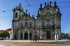 Porto, Portugal. August 12, 2017: Baroque facades of the churches of Carmen and the Discalced Carmelites in the square called Gome. S Teixeira in the center of stock images