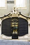 Porto, Portugal. August 12, 2017: beautiful door of a jewelry store with adornments of two angels on top and wooden door and windo. Ws located on the street on royalty free stock photos