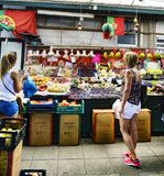 Porto, Portugal. August 12, 2017: Fruit and vegetable stand in a market hall called Do Bolhao in the center of the city with two y stock image