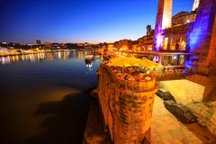 Nightlife in Porto. Porto, Portugal - August 10, 2017: Nightlife in Porto: bars, clubs and restaurants at Ribeira waterfront illuminated by night. Scenic view Royalty Free Stock Images