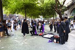 Porto, Portugal. August 12, 2017: Tuna from the University of Oporto singing to two women with two of the kneeling tunos declaring. Themselves to women and the Stock Image