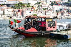 Porto, Portugal, August 21, 2018: Two tourist boats stand on the pier of the Douro river. On the opposite Bank-the historic part stock images