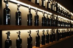 Porto, Portugal, August 21, 2018: wine cellars. Three rows of bottles of port under artificial light. Selective focus stock photo