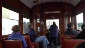 Porto, Portugal, circa 2018: Interior of an old tram, passing through the streets of Porto, Portugal. Porto, Portugal, circa 2018: Interior of an old tram stock video