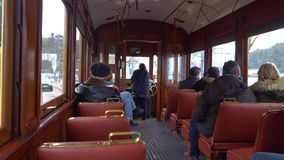 Porto, Portugal, circa 2018: Interior of an old tram, passing through the streets of Porto, Portugal. Porto, Portugal, circa 2018: Interior of an old tram stock video footage