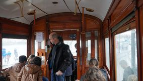 Porto, Portugal, circa 2018: Interior of an old tram, passing through the streets of Porto, Portugal. Stock Image