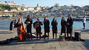 Porto, Portugal - circa October 2018:Young Students play classical portuguese music. Porto, Portugal - circa October 2018:Young Students music band at the douro royalty free stock photo