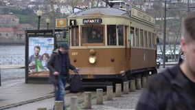 Porto, Portugal, circa 2018: Old tram passing by in the old town of Porto Portugal. Porto, Portugal, circa 2018: Old tram passing by in the old town of Porto stock video footage