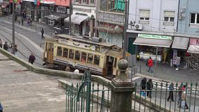 Porto, Portugal, circa 2018: Old tram passing by in the old town of Porto Portugal. Porto, Portugal, circa 2018: Old tram passing by in the old town of Porto stock video
