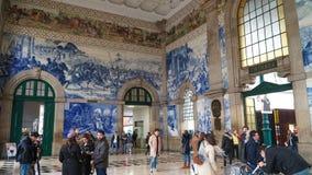 Porto, Portugal, circa 2018: Traditional Portuguese painted tiles azulejos depicting Portuguese history inside the Porto Train Sta. Tion Stock Image