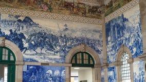 Porto, Portugal, circa 2018: Traditional Portuguese painted tiles azulejos depicting Portuguese history inside the Porto Train Sta. Tion Stock Photos